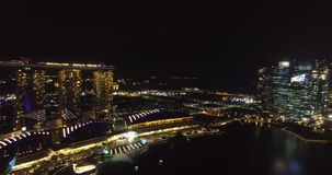 Aerial panorama of night Singapore and Marina Bay Sands Hotel stock footage