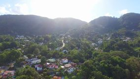 Aerial panorama of Ocean and Houses on the beach of tropical Island, Seychelles. Drone shot panorama of Beau Vallon Beach, Ocean and houses on the beach on stock video