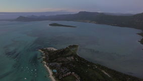 Aerial panorama of ocean and Mauritius Island. Aerial Mauritius and ocean. Flying over Le Morne Brabant peninsula with distant view of mountain landscape stock video