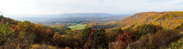 Aerial Panorama Of Mountain Covered By Forests In Autumn Colors Royalty Free Stock Image