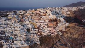 Aerial panorama of Oia town at sunset, Santorini stock video