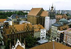Aerial panorama of Old Town with St. Mary`s Church and Artus Court. In Torun, Poland stock photography