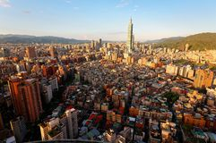 Aerial panorama over Downtown Taipei, capital city of Taiwan with view of prominent Taipei 101 Tower amid skyscrapers royalty free stock images