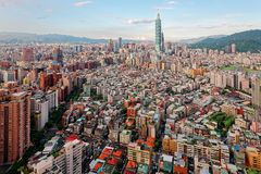 Aerial panorama over Downtown Taipei, capital city of Taiwan with view of prominent Taipei 101 Tower amid skyscrapers Stock Photos