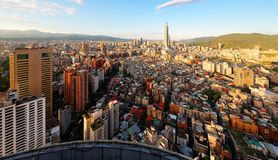 Aerial panorama over Downtown Taipei, capital city of Taiwan with view of prominent Taipei 101 Tower amid skyscrapers royalty free stock photography