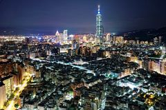 Aerial panorama over Taipei after dark, the capital city of Taiwan royalty free stock photo