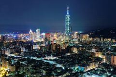 Aerial panorama over Taipei after dark, the capital city of Taiwan, with Taipei 101 Tower among skyscrapers stock image