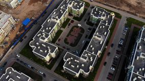 Aerial panorama on rooftop and housing construction. Flying over residential house and building yard stock video footage