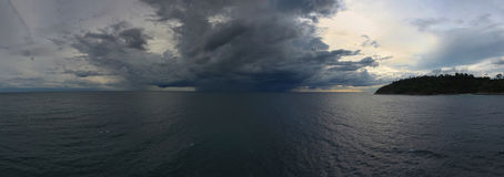 Aerial panorama of sea and thunderstorm. Aerial panorama landscape of sea and thunderstorm on horizon Royalty Free Stock Image