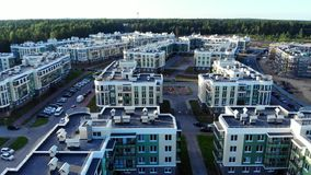Aerial panorama on small town in North Europe, modern buildings rooftops.