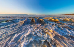 Aerial panorama of snow sunrise wave on the shore of Olkhon. Bai Royalty Free Stock Image