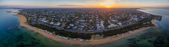 Aerial panorama of sunrise over Brighton suburb, showing iconic Stock Photos