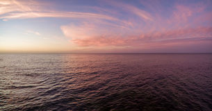 Aerial panorama of sunset over ocean. Nothing but sky, clouds an Stock Photo