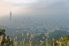 Aerial panorama of Taipei City at foggy dusk with view of Taipei buildings in downtown area Royalty Free Stock Photography