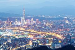 Aerial panorama of Taipei downtown & suburbs at dusk with view of Keelung Riverside Park Stock Photo