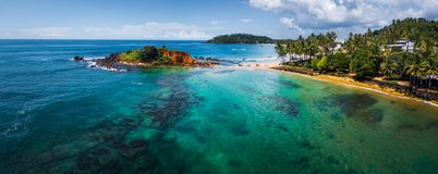 Aerial panorama of the tropical beach. And clear sea with coral reefs in the town of Mirissa, Sri Lanka Royalty Free Stock Image