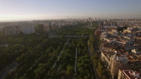 Aerial panorama of Valencia, Spain. View to the path in green park with following aerial panorama of Valencia, Spain stock footage