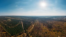 Aerial panorama view from above of nature landscape with forest and rural countryside, beautiful scenery landmark Royalty Free Stock Image