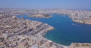 Aerial panorama view- Ancient capital city of Valletta. Malta with port, cathedral and old town. Island Country of Europe in the Mediterranean Sea stock video footage