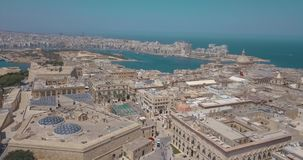 Aerial panorama view of Ancient capital city of Valletta, Malta. Aerial panorama view- Ancient capital city of Valletta Malta with port, cathedral and old town stock footage