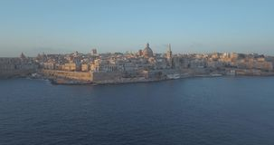 Aerial panorama view of Ancient capital city of Valletta, Malta. Aerial panorama view- Ancient capital city of Valletta Malta with port, cathedral and old town stock video footage