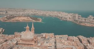 Aerial panorama view of Ancient capital city of Valletta, Malta. Aerial panorama view- Ancient capital city of Valletta Malta with port, cathedral and old town stock video