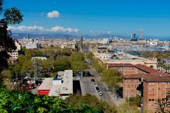Aerial Panorama view of Barcelona city skyline over Passeig de C. Olom or Columbus avenue and Port Vell marina stock image