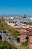 Aerial Panorama view of Barcelona city skyline over Passeig de C. Olom or Columbus avenue and Port Vell marina royalty free stock photography