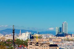 Aerial Panorama view of Barcelona city skyline over Passeig de C. Olom or Columbus avenue and Port Vell marina stock photography