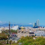 Aerial Panorama view of Barcelona city skyline over Passeig de C. Olom or Columbus avenue and Port Vell marina royalty free stock images