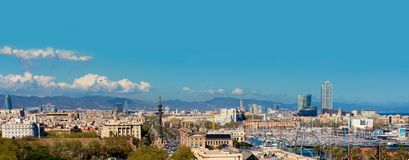 Aerial Panorama view of Barcelona city skyline over Passeig de C. Olom or Columbus avenue and Port Vell marina royalty free stock image