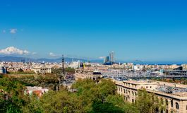 Aerial Panorama view of Barcelona city skyline over Passeig de C. Olom or Columbus avenue and Port Vell marina stock photos