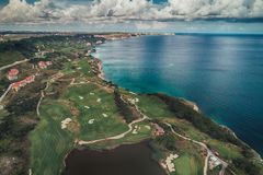 Aerial panoramic view of a golf course next to the cliffs and Bl Royalty Free Stock Image
