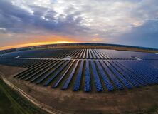 Free Aerial Panorama View Into Large Solar Panels At A Solar Farm At Bright Sunset. Solar Cell Power Plants Stock Images - 199774824