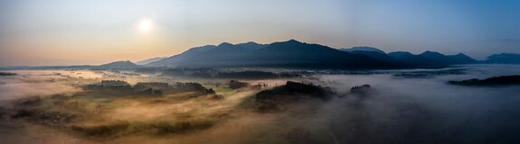Free Aerial Panorama View Of Autumn Sunset In Mountains With Fog And Cloud Valley Landscape. Sun, Haze. Blomberg, Isartal Stock Images - 197771264