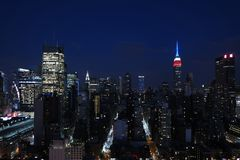 Aerial and panorama view of skyscrapers of New York City, Manhattan. view of night midtown of Manhattan with stars and moon royalty free stock photo