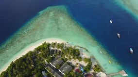 Aerial panorama view of tropical island resort hotel with white sand palm trees and turquoise Indian ocean on Maldives stock video footage