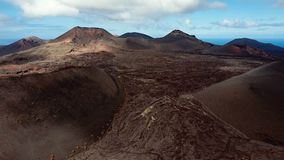 Aerial panorama of volcanic valley near Timanfaya National Park, Lanzarote. stock footage