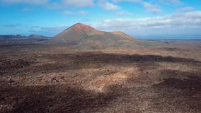 Aerial panorama of volcanic valley near Timanfaya National Park, Lanzarote. stock video