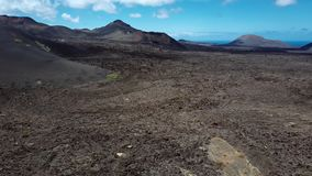 Aerial panorama of volcanic valley near Timanfaya National Park, Lanzarote. Flying over volcanos near Timanfaya National Park, Lanzarote, Canary islands, Spain stock video