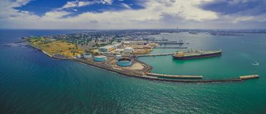 Aerial panorama of Williamstown suburb and industrial wharfs. Aerial panorama of Williamstown suburb and industrial wharfs in summer. Melbourne, Australia Stock Image