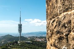 Aerial panoramic or cityscape view of the green forest hills of Barcelona Catalonia, Spain and TV tower Torre de Collserola stock photography