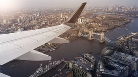 Aerial cityscape view of London. Aerial panoramic cityscape view of London and the River Thames with tower Bridge, Tower of London and City Hall with airplane Royalty Free Stock Photos