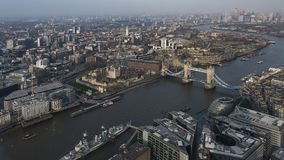 Aerial cityscape view of London. Aerial panoramic cityscape view of London and the River Thames with tower Bridge, Tower of London, City Hall in front and Canary Royalty Free Stock Images