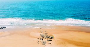 Aerial Panoramic Drone View Of Blue Ocean Waves And Beautiful Beach in Portugal Royalty Free Stock Images