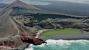 Aerial panoramic flyover of the green lake of El Golfo. Lanzarote stock footage