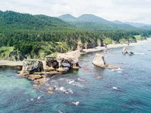 Aerial panoramic photo of cape Ptichiy nearby cape Velikan, Sakhalin island, Russia Sahalin. Surrealistic landscape of arches. royalty free stock images