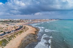 Aerial Panoramic Photo Of La Mata Beach. Surfers Ride The Waves. Province Of Alicante Costa Blanca. South Of Spain Royalty Free Stock Photography