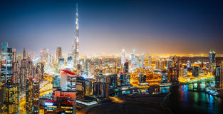 Aerial panoramic skyline of a big futuristic city by night. Business bay, Dubai Stock Photos