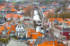 Aerial panoramic street view with canal and houses in Delft, Holland Stock Photo